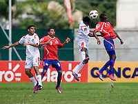 Dario Wright (7) of Panama fights goes up for a header with Jake Beckford (7) of Costa Rica during the quarterfinals of the CONCACAF Men's Under 17 Championship at Catherine Hall Stadium in Montego Bay, Jamaica. Panama defeated Costa Rica, 1-0.