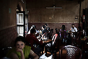 Bengali intelligentsia  are known to spend time at the India Coffee House on College Street in Calcutta (Kolkata) in India. Photographer: Sanjit Das.