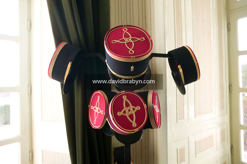 Officers' hats hand on a coat hanger at the officers' mess of the French Foreign Legion headquarters in Aubagne, France, 10 December 2007.