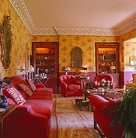 The red and yellow toile de Jouy living room incorporates Chinoiserie accents in its decoration