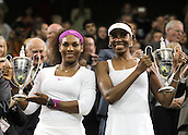 07.07.2012. The Wimbledon Tennis Championships 2012 held at The All England Lawn Tennis and Croquet Club, London, England, UK. Serena Williams  and Venus Williams of The United States Pose with Their Trophies during The Awards Ceremony for The Ladies Doubles Final Against Andrea Hlavackova and Lucie Hradecka of Czech Republic AT The Wimbledon Championships 2012 in London