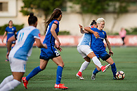 Seattle, WA - Sunday, May 21, 2017: Megan Rapinoe and Camila Martins Pereira during a regular season National Women's Soccer League (NWSL) match between the Seattle Reign FC and the Orlando Pride at Memorial Stadium.