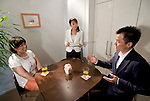 """""""Keiko"""" (l) undertakes a class simulating a first date with her unidentified coach at Infini, a school training marriage hopefuls how to hook Mr. or Mrs. Right in Tokyo, Japan on Sep. 9, 2010. At center, school head Etsuko Satake critiques the session."""