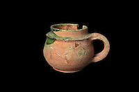 A small terracotta cooking pot with a handle, 16th century, from the excavations of 1995 led by Francois Blary, from the North section of the upper courtyard in the kitchen area at the medieval castle of Chateau-Thierry, Picardy, France. The first fortifications on this spur over the river Marne date from the 4th century and the first castle was built in the 9th century Merovingian period by the counts of Vermandois. Thibaud II enlarged the castle in the 12th century and built the Tour Thibaud, and Thibaud IV expanded it significantly in the 13th century to include 17 defensive towers in the walls and an East and South gate. The castle was largely destroyed in the French Revolution after having been a royal palace since 1285. In 1814 it was used as a citadel for Napoleonic troops. Picture by Manuel Cohen