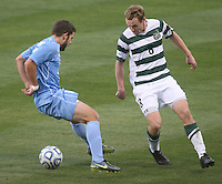 North Carolina's Ben Speas, left, puts a move on Charlotte's Aidan Kirkbride during the NCAA 2011 Men's College Cup in Hoover, AL on Sunday, December 11, 2011.