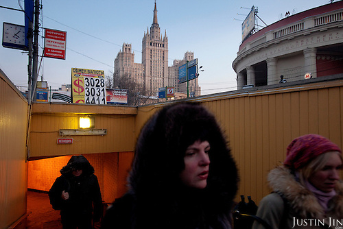 People walk out of the tunnel at the Kransnopresnenskaya metro station on the ring line. .The Moscow Metro, which spans almost the entire Russian capital, is the world's second most heavily used metro system after the Tokyo's twin subway. Opened in 1935, it is well known for the ornate design of many of its stations, which contain outstanding examples of socialist realist art.