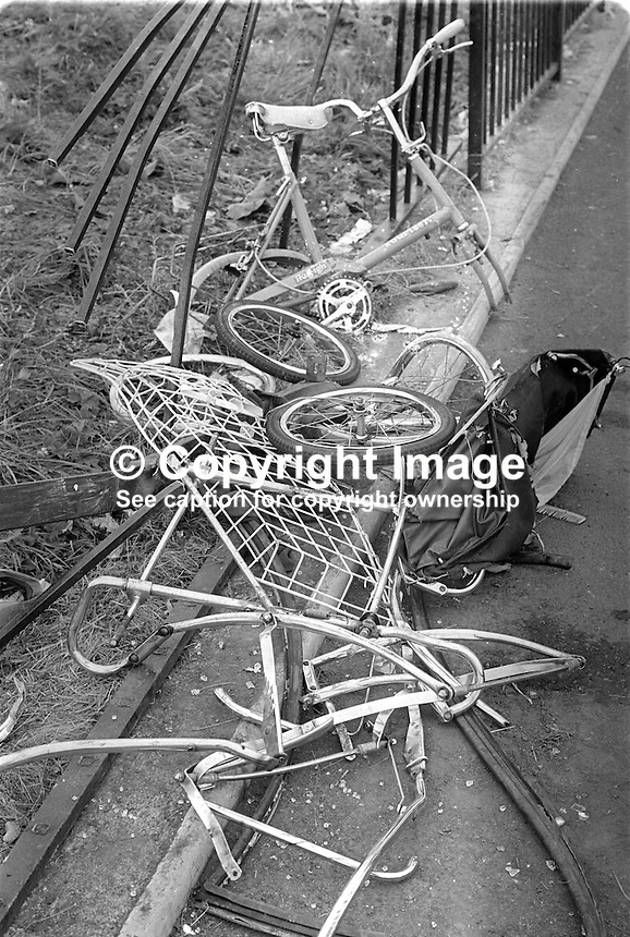 The mangled remains of a pram and a child's bike at the railings outside St John the Baptist school on Finaghy Road North, Belfast, where the three Maguire children died or were fatally injured on 10th August 1976. The incident occured when British soldiers fired on the car and fatally wounded the driver, Provisional IRA volunteer, Danny Lennon, 23 years, causing the vehicle to go out of control and mount the footpath. Joanne Maguire, 8 years, and her brother, Andrew Maguire, 6 weeks, were killed instantly. John Maguire, 2 years, died the following day. Their mother, Anne Maguire, never fully recovered and took her own life on 21st January 1980. The children's deaths triggered the formation of the Peace People movement. 197608100362. <br /> <br /> Copyright Image from Victor Patterson,<br /> 54 Dorchester Park, Belfast, UK, BT9 6RJ<br /> <br /> t1: +44 28 90661296<br /> t2: +44 28 90022446<br /> m: +44 7802 353836<br /> <br /> e1: victorpatterson@me.com<br /> e2: victorpatterson@gmail.com<br /> <br /> For my Terms and Conditions of Use go to<br /> www.victorpatterson.com