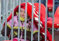 06 April 2013: A young Toronto FC fan decides that the steel railings are far more interesting than an MLS game between FC Dallas and Toronto FC at BMO Field in Toronto, Ontario Canada..The game ended in a 2-2 draw..