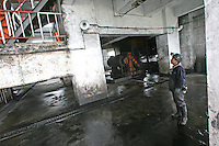 A coal miner stands in Yangchangwan coal mine, part of Shenhua group, in Ning Dong, near Yinchuan, Ningxia province, China, Monday, July 10, 2006. China Shenhua Energy is planning the world's biggest share sale by a coal mining company, hoping to raise as much as $6.3 billion to expand pits and delivery networks as demand for the fuel surges. Photo by Servais Mont/Pictobank