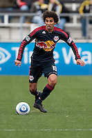 Mar 26, 2011; Columbus, OH, USA; New York Red Bulls midfielder Mehdi Ballouchy (10) carries the ball across the width of the field against the Columbus Crew during their match at Columbus Crew Stadium. The game finished in a 0-0 tie.