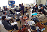 Carl Sundberg (right) and other staff from Smart Technology Partners hold a meeting inside a former elementary school in  Aizu-misato town, Fukushima Prefecture, Japan on 20 April 2013.  Photographer: Rob Gilhooly