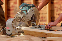 Builder using power saw <br />