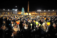 Girls,Boys,members of the ecumenical christian community of Taize pray with Pope Benedict XVI the prayer with the ecumenical christian community of Taize in St.Peter's square at the Vatican. December 29, 2012..