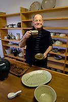 Potter Harvey Young holding one of his pots. Harvey Young Pottery, Mashiko, Japan, May 11, 2013. Mashiko is one of Japan's leading pottery towns, famous for its association with master potter Shoji Hamada.