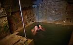Zefad. A man takes a ritual bath in Ari Mikvah