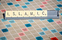Islamic spelled out in Scrabble Letters.