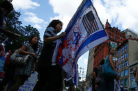 New York, USA. 24 July 2014. A woman carries a Israel flag with fake blood during a protest by Palestine supporters in New York, demanding the end of the war by Israel and Hamas in Gaza. Photo by Eduardo Munoz Alvarez/VIEWpress