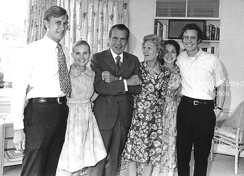"""Washington, DC -- White House Photo from 7 August, 1974 of the Nixon Family prior to the President's announcement of his resignation. (L-R) Edward Cox; Tricia (Nixon) Cox; United States President Richard Nixon; Mrs. Richard Nixon (Patricia or """"Pat""""); Julie (Nixon) Eisenhower; and David Eisenhower..Credit: The White House via CNP"""