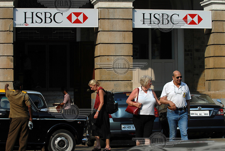 Tourists outside a branch of the HSBC bank in central Mumbai.