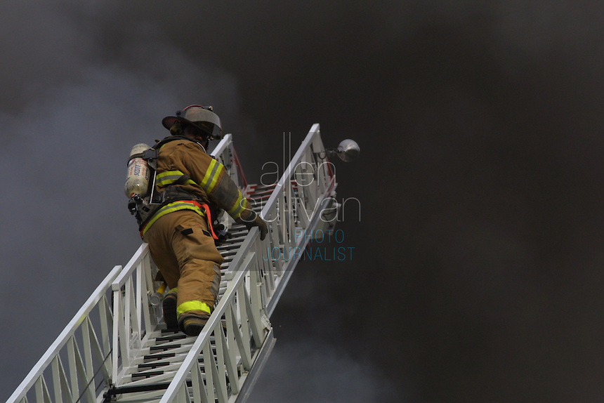 Atlanta firefighters work on a blaze at Grant Park's Neighborhood Charter School in Atlanta, Georgia. The school has since reopened.