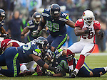 Seattle Seahawks Strong Safety Kam Chancellor (31) and defense end Red Bryant (79) grabs  Arizona Cardinals running back Rashard Mendenhall (28) during the first quarter at CenturyLink Field in Seattle, Washington on December 22, 2013.   The Cardinals beat the Seahawks 17-10. ©2013. Jim Bryant Photo. ALL RIGHTS RESERVED.