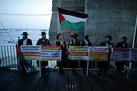 New York City, NY. 20 August 2014. A group of rabbis holds banners as they takes part during a Pro-palestine Rally across de Brooklyn Bridge in Manhattan.  Photo by Kena Betancur/VIEWpress