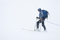 Back country skiing on the Ruth Glacier in white-out conditions.  Alaska range mountains, interior, Alaska.