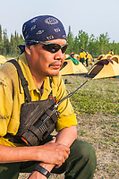 Firefighter Shane Sam, from Northway, Alaska, at the base camp at the Tok school in Tok, Alaska.  Crew boss of 20 from the Interior Alaska Wildfire Academy. Working on the Eagle Trail wildland forest fire, May 2010.