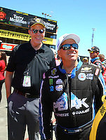 Jul 30, 2016; Sonoma, CA, USA; NHRA president Peter Clifford (left) with funny car driver John Force during qualifying for the Sonoma Nationals at Sonoma Raceway. Mandatory Credit: Mark J. Rebilas-USA TODAY Sports