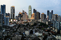 An overview of Chongqing city, one of the fastest-growing and biggest cities on earth, with a population of 29 million. The slum area under the high-rises is marked for demolition in the near future. Situated in southwestern China, away from the coast, it is the engine of China's inland economic development. The Chinese government plans to move 250 million rural residents into urban areas over the coming dozen years though it is unclear whether people want to move and where the money for this project will come from. Further urbanisation is meant to drive up consumption to counterbalance an export orientated economy and end subsistence farming but the drive to get people off the land is causing tens of thousands of protests each year. /Felix Features