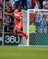 Chicago midfielder Patrick Nyarko (14) heads the ball.  The Chicago Fire tied Chivas USA 1-1 at Toyota Park in Bridgeview, IL on May 1, 2010.