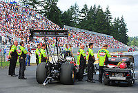 Aug. 7, 2011; Kent, WA, USA; Crew members for NHRA top fuel dragster driver Terry McMillen during the Northwest Nationals at Pacific Raceways. Mandatory Credit: Mark J. Rebilas-