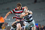 Adam Cathcart has his run stopped by Gareth Anscombe and Hadleigh Parkes.  ITM Cup Round 7 rugby game between Auckland and Counties Manukau, played at Eden Park, Auckland on Thursday August 11th..Auckland won 25 - 22.