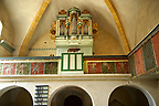 Organ & saon folk art of the Gothic interior of the 14th Century Axente Sever Fortified Church, Transylvania.