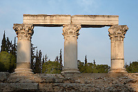 CORINTH, GREECE - APRIL 16 : A detail of Temple E, on April 16, 2007 in Corinth, Greece. Originally built during the early Augustan period, 1st century BC, Temple E was rebuilt after the earthquake of 77 AD. These three fine Corinthian capitals and columns, two of which have been reconstructed, are seen in the early morning light. Corinth, founded in Neolithic times, was a major Ancient Greek city, until it was razed by the Romans in 146 BC. Rebuilt a century later it was destroyed by an earthquake in Byzantine times. (Photo by Manuel Cohen)