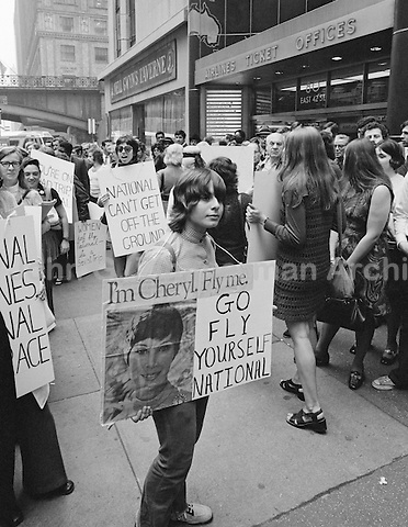 "The National Organization for Women (NOW) protests the ""Fly Me"" ad campaign released in 1971 by National Airlines. NOW denounced the campaign for the depiction of women as sex objects. New York City. Photo by John G. Zimmerman."