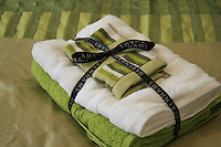 Debenhams towel set, fresh lime green, white, bed set, black ribbon, gold, golden duvet cover, stripped greens, towels on a bed,