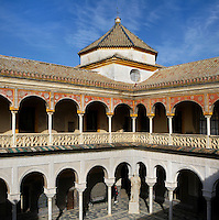 High angle view of the central patio with Roman statue of Minerva and upper portico, Casa de Pilatos, Seville, Spain, pictured on December 30, 2006, in the afternoon. Pilate's House, late 15th century, was built by the Enriquez and Ribera families During the 16th century these families, who had a strong relationship with Italy,  introduced the Renaissance style to Seville. In the palace is the sculpture collection of the Duke of Alcala  who brought back many Classical pieces from Italy and adapted the palace and gardens to exhibiting them in Renaissance style. The buildings were further modified according to Romantic taste in the 19th century and now present a combination of Mudejar-Gothic, Renaissance and Romantic styles. Today the Casa de Pilatos belongs to the Fundacion Casa Ducal de Medicaneli and is the residence of the Dukes of Medicaneli. Picture by Manuel Cohen.