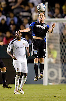 San Jose Earthquake midfielder Sam Cronin (4) leaps high for a head ball. The LA Galaxy and the San Jose Earthquakes played to a 2-2 draw at Home Depot Center stadium in Carson, California on Thursday July 22, 2010.