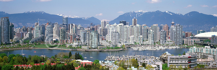 "City of Vancouver Skyline and Downtown at Yaletown and ""False Creek"", British Columbia, Canada, in Spring.  The North Shore Mountains (Coast Mountains) rise above the City. - Panoramic View"