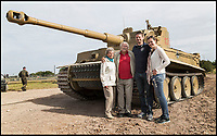BNPS.co.uk (01202 558833)<br /> Pic: TankMuseum/BNPS<br /> <br /> Wilhelm Fischer - a Tiger tank veteran, with family.<br /> <br /> This is the poignant moment two German Tiger tank drivers and their British counterparts met for the first time 72 years after they fought on opposite sides in the Second World War.<br /> <br /> Wilhelm Fischer and Waldemar Pliska helped instill terror in British troops by manning the fearsome fighting machines and unleashing hell with their huge 88mm guns.<br /> <br /> Two of the enemy with first hand experiences of the heavily armoured Tigers were British tank men Ernest Slarks and Dr Ken Tout.<br /> <br /> Now aged in their 90s the four old foes became friends when they assembled for the launch of an historic exhibition at the Tank Museum in Bovington, Dorset.