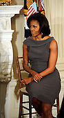 First lady Michelle Obama listens as Dr. Jill Biden delivers remarks to the National Governors Association during a meeting in the White House State Dining Room, on Monday, February 27, 2012, in Washington, DC. .Credit: Leslie E. Kossoff / Pool via CNP