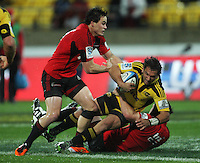 Zac Guildford and Matt Todd tackle Aaron Cruden. Super 15 rugby match - Crusaders v Hurricanes at Westpac Stadium, Wellington, New Zealand on Saturday, 18 June 2011. Photo: Dave Lintott / lintottphoto.co.nz