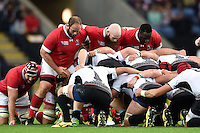 The Canada front row of Doug Wooldridge, Ray Barkwill and Djustice Sears-Duru pack down for a scrum. Rugby World Cup Pool D match between Canada and Romania on October 6, 2015 at Leicester City Stadium in Leicester, England. Photo by: Patrick Khachfe / Onside Images