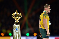 A dejected David Pocock of Australia walks past the Webb Ellis Cup. Rugby World Cup Final between New Zealand and Australia on October 31, 2015 at Twickenham Stadium in London, England. Photo by: Patrick Khachfe / Onside Images