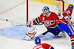 22 November 2008: Montreal Canadiens' goaltender Carey Price makes a save in the third period against the Boston Bruins at the Bell Centre in Montreal, Quebec, Canada.  After a 2-2 regulation tie and a non-scoring 5-minute overtime period, the Boston Bruins scored the lone shootout goal thus defeating the Canadiens 3-2. The Canadiens, celebrating their 100th season, honored former Montreal goaltender Patrick Roy, and retired his jersey (Number 33) during pre-game ceremonies. ***** Editorial Use Only *****..Mandatory Photo Credit: Ed Wolfstein Photo *** Editorial Sales through Icon Sports Media *** www.iconsportsmedia.com