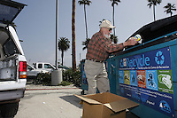 Tuesday, May 12, 2009.  Mission Beach, San Diego, CA, USA.  78-year-old Mission Beach Resident Bill Bradshaw unloads recyclabes from his truck into the drop-off containers on Santa Clara Point in Mission Beach.  District 2 councilmember Kevin Faulconer announced today that he plans to use $80K of discretionary funds to continue a long-standing program of supplemental trash pick-ups from residents in Mission Beach during the summer months.