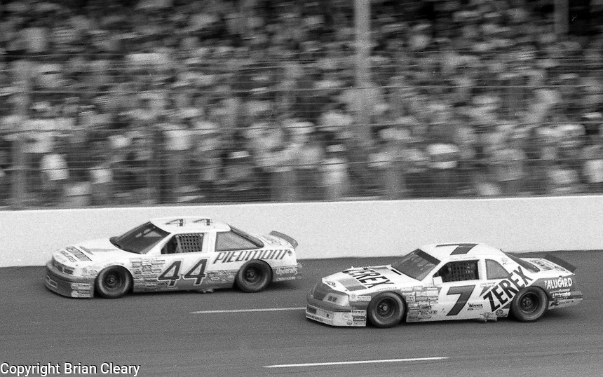Sterling Marlin 44 Oldsmobile Alan Kulwicki 7 Ford action the Southern 500 at Darlington Raceway in Darlington, SC in September 1988. (Photo by Brian Cleary/www.bcpix.com)