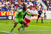 Chicago Fire goalkeeper Sean Johnson (25) battles for the ball with Tim Cahill (17) of the New York Red Bulls. The Chicago Fire defeated the New York Red Bulls 2-0 during a Major League Soccer (MLS) match at Red Bull Arena in Harrison, NJ, on October 06, 2012.