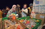 Refugees and migrants receive food and blankets from Hungarian Interchurch Aid, a member of the ACT Alliance, as they leave the Hungarian town of Hegyeshalom late at night and prepare to cross the border into Austria. Hundreds of thousands of refugees and migrants flowed through Hungary in 2015, on their way to western Europe from Syria, Iraq and other countries.